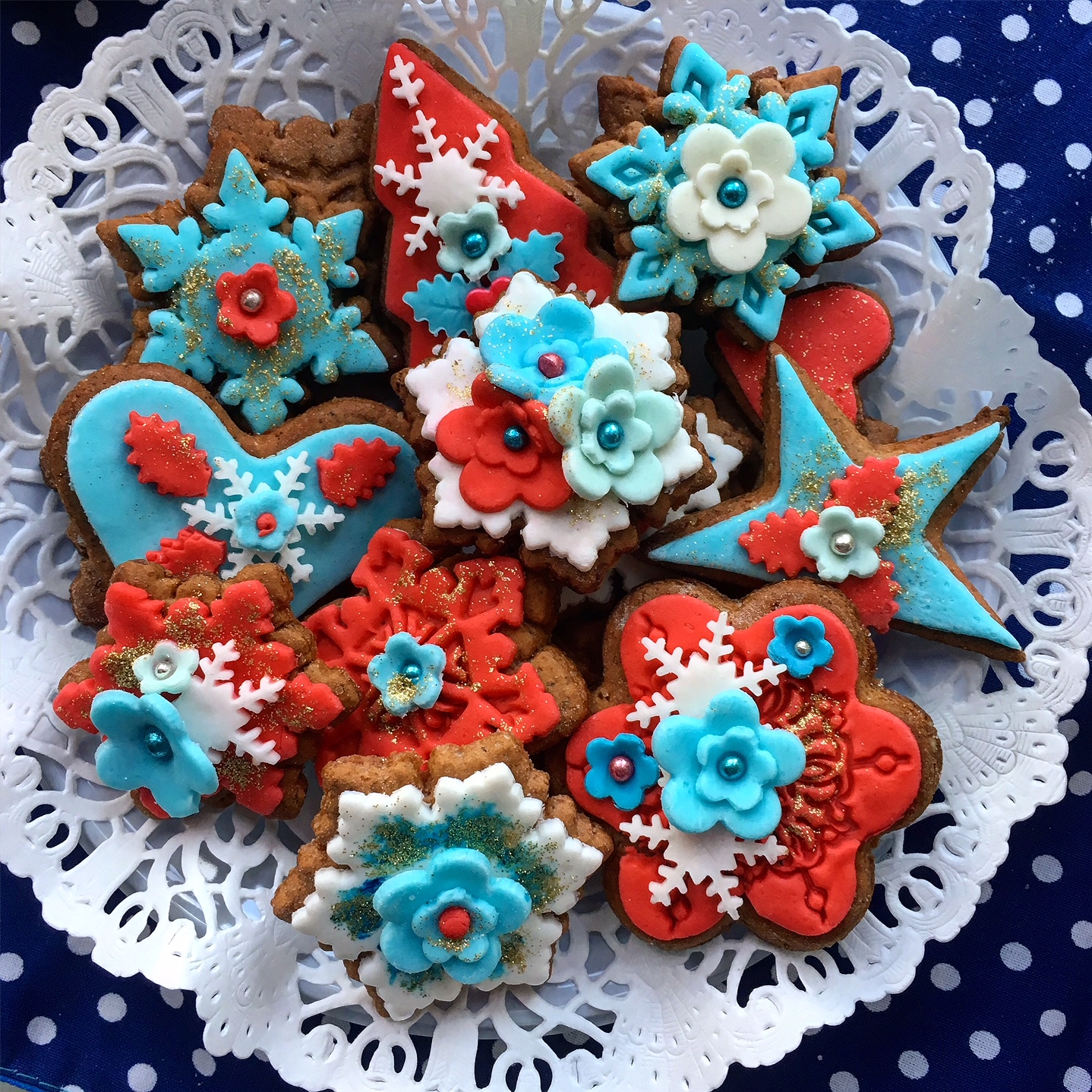 Christmas gingerbread cookies with red, blue and white decoration with some glitter