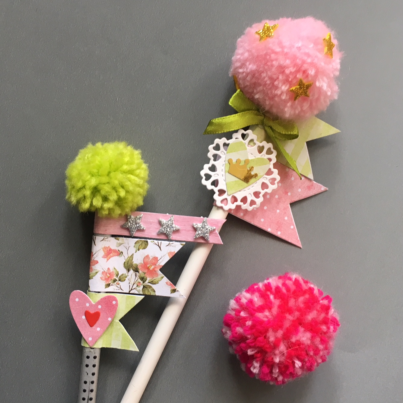 pencils, decorated with pompoms, hearts and ribbon bows