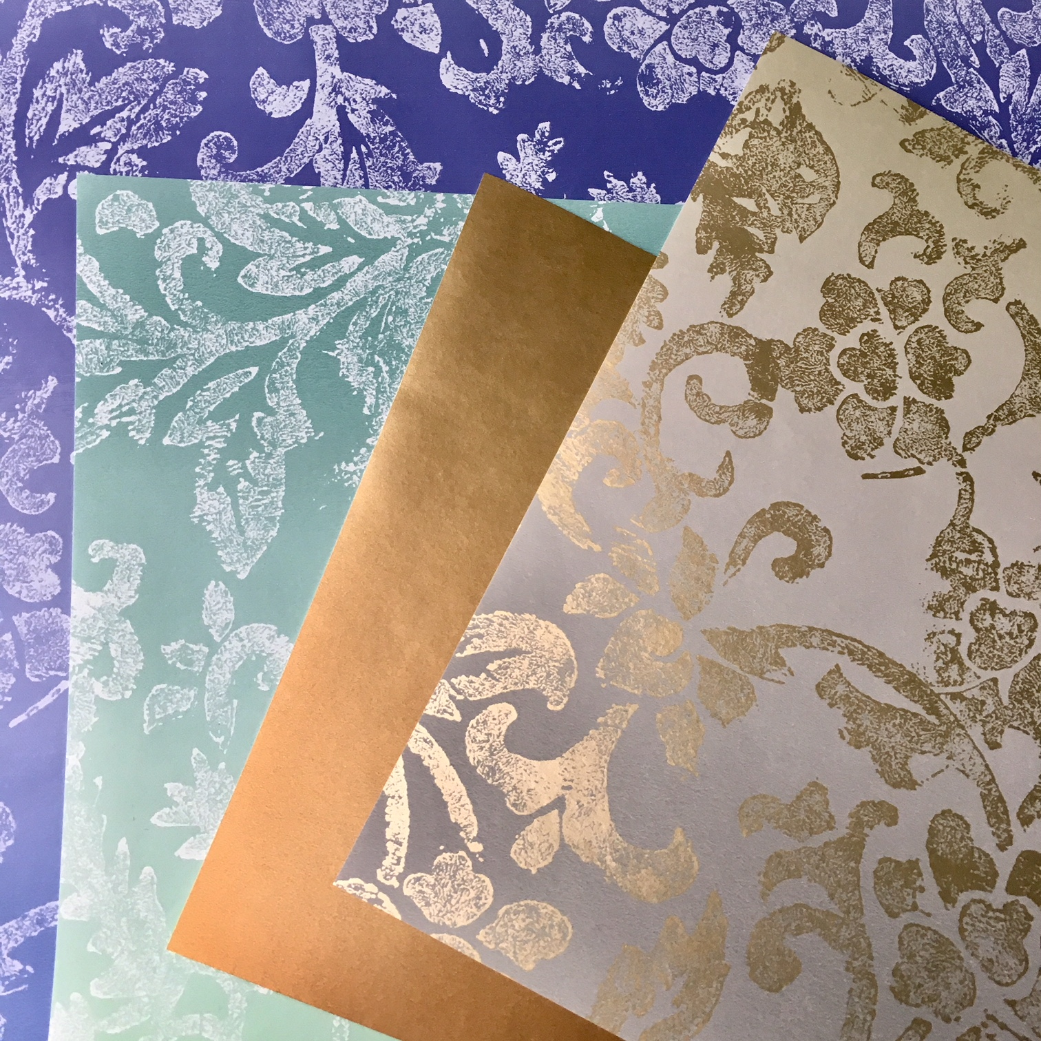 wallpaper pieces in blue, turquoise and gold