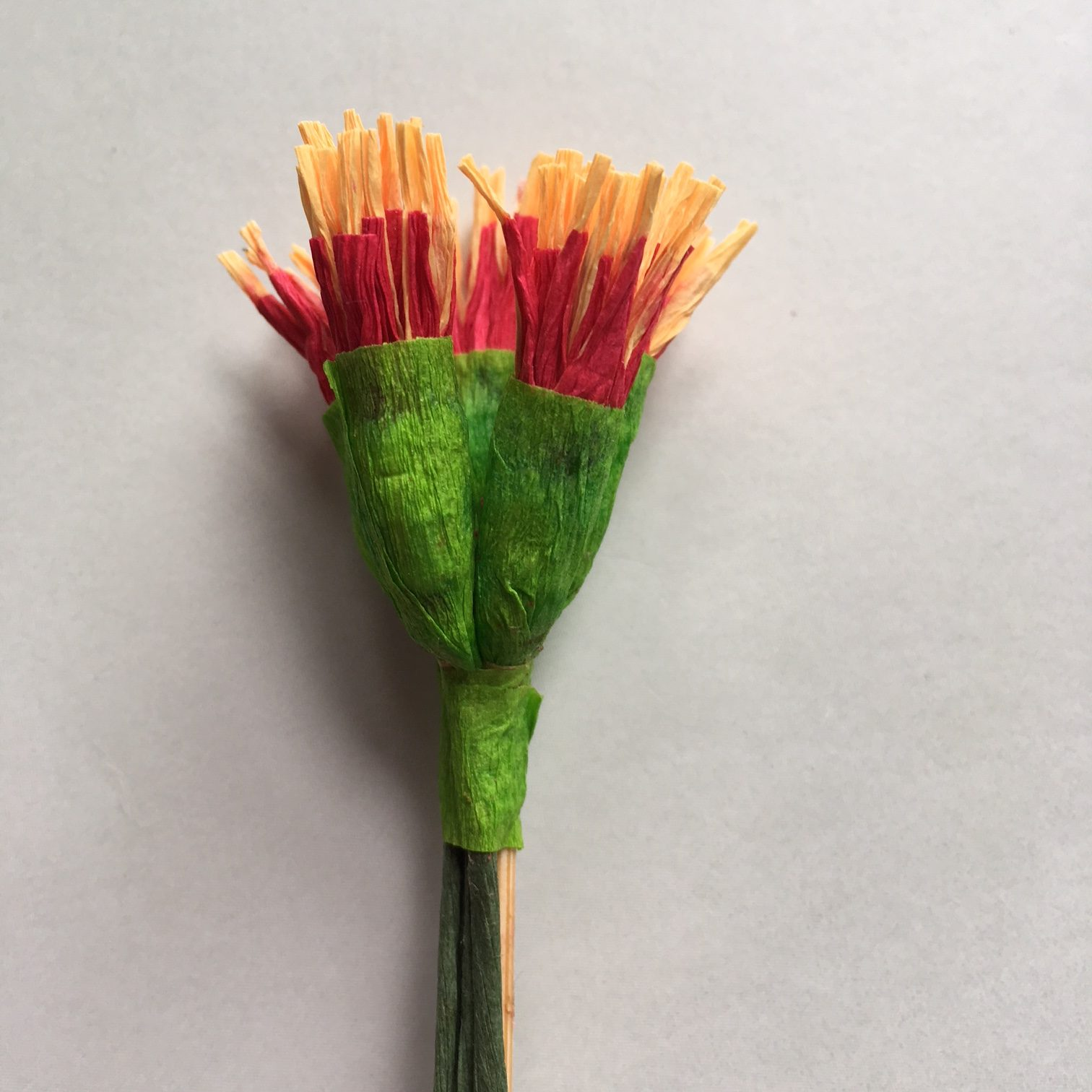 5 stamen heads of crepe paper Poinsettia glued together