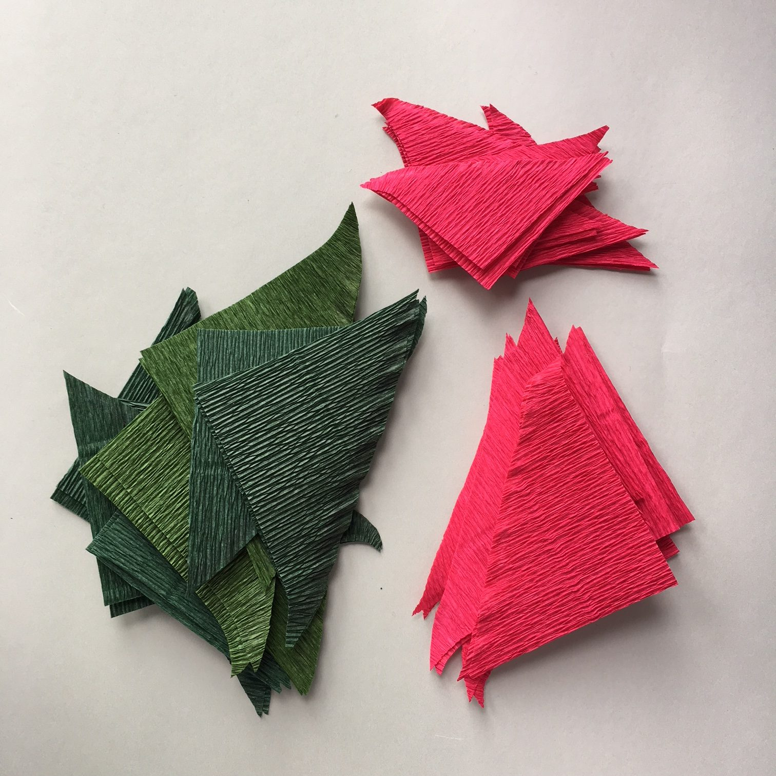 glued together green and red rectangles of crepe paper