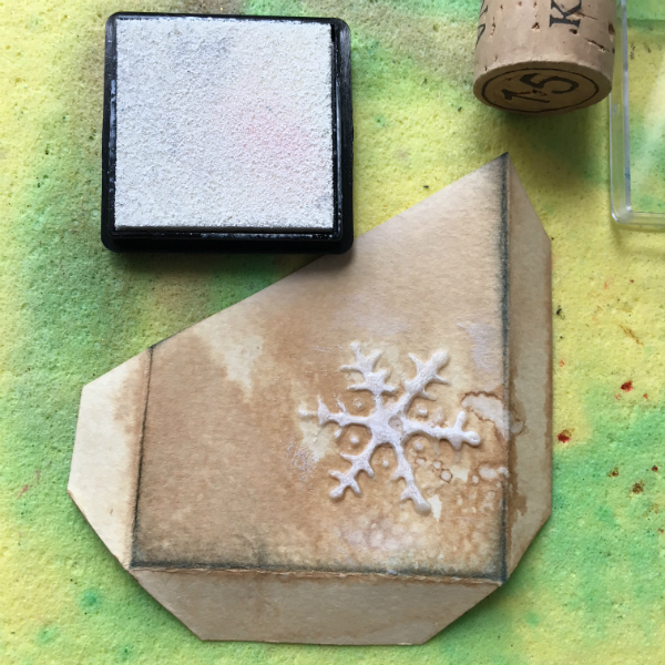 white ink pad and white coloured modelling paste snowflake