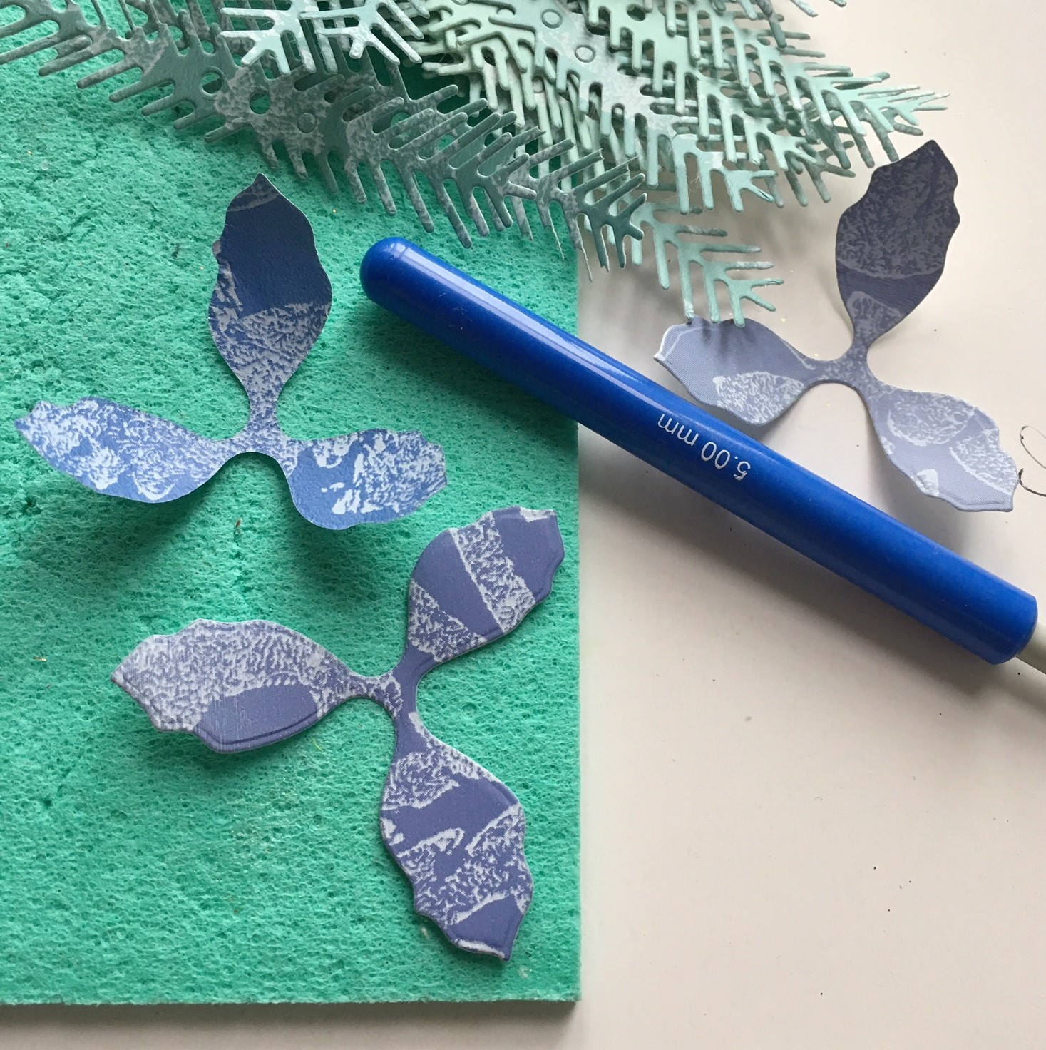 making blue poinsettia paper flowers from the blue wallpaper