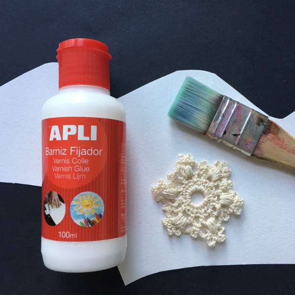 Apli varnish glue, brush and crocheted snowflake