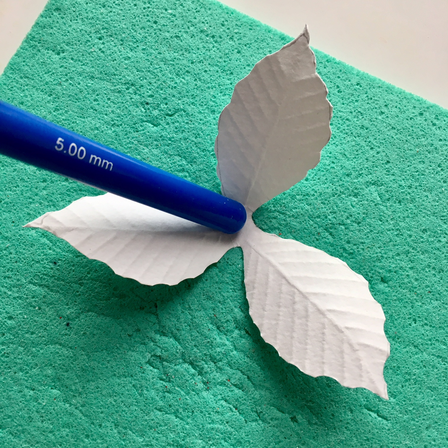 shaping the petals with croshet hook