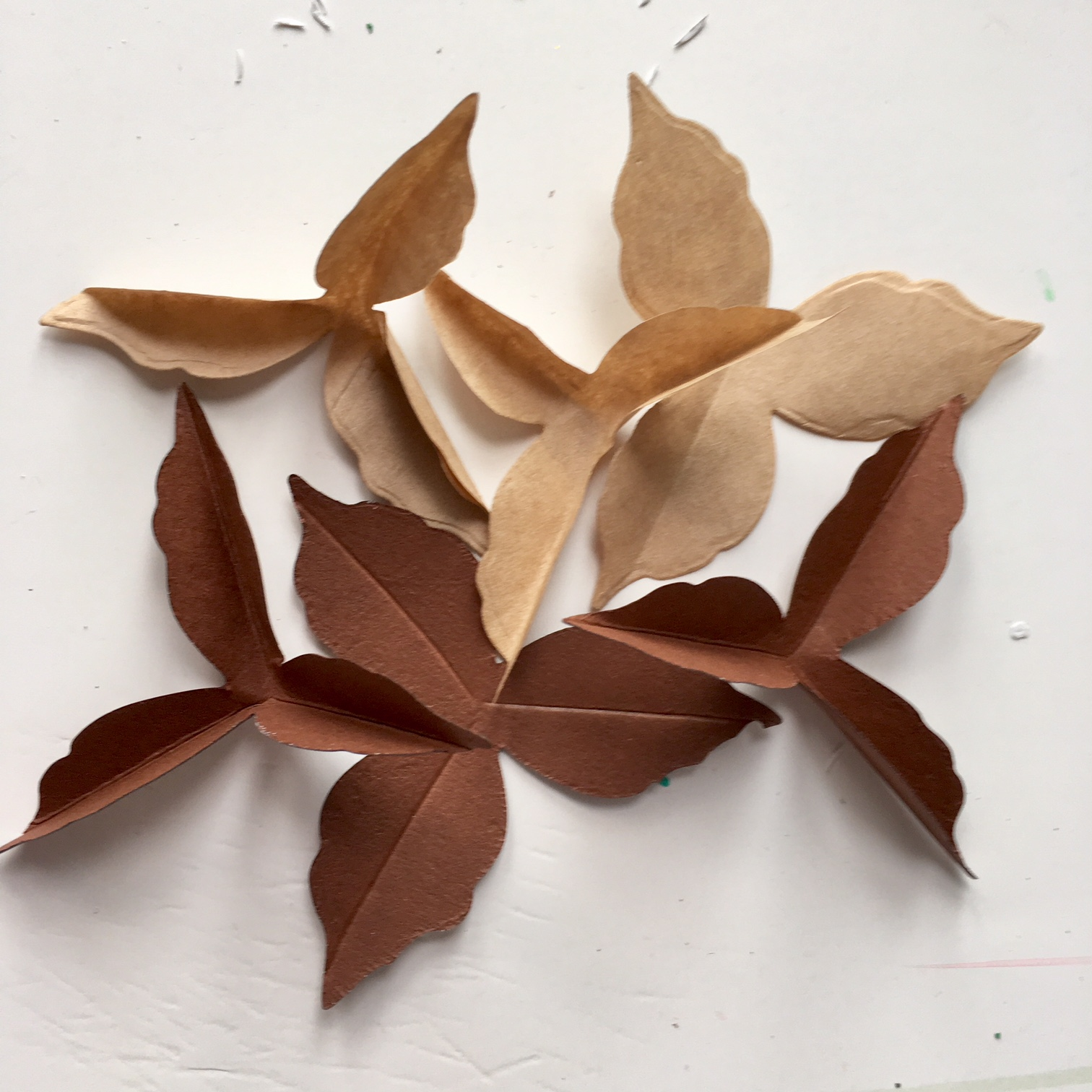 frugal craft Christmas wreath- brown paper cotton leaf shapes