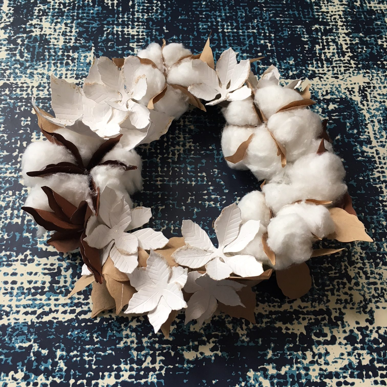 Christmas wreath with white paper Poinsettia flowers and paper cotton flowers