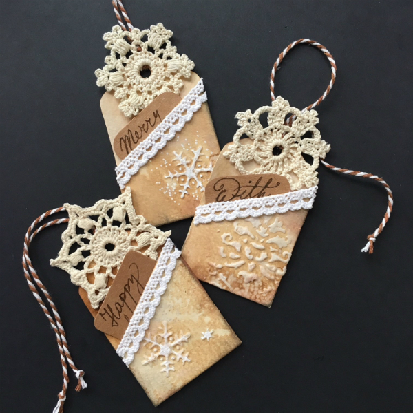 vintage looking Christmas pocketed gift tags with crocheted snowflakes and white lace decoration