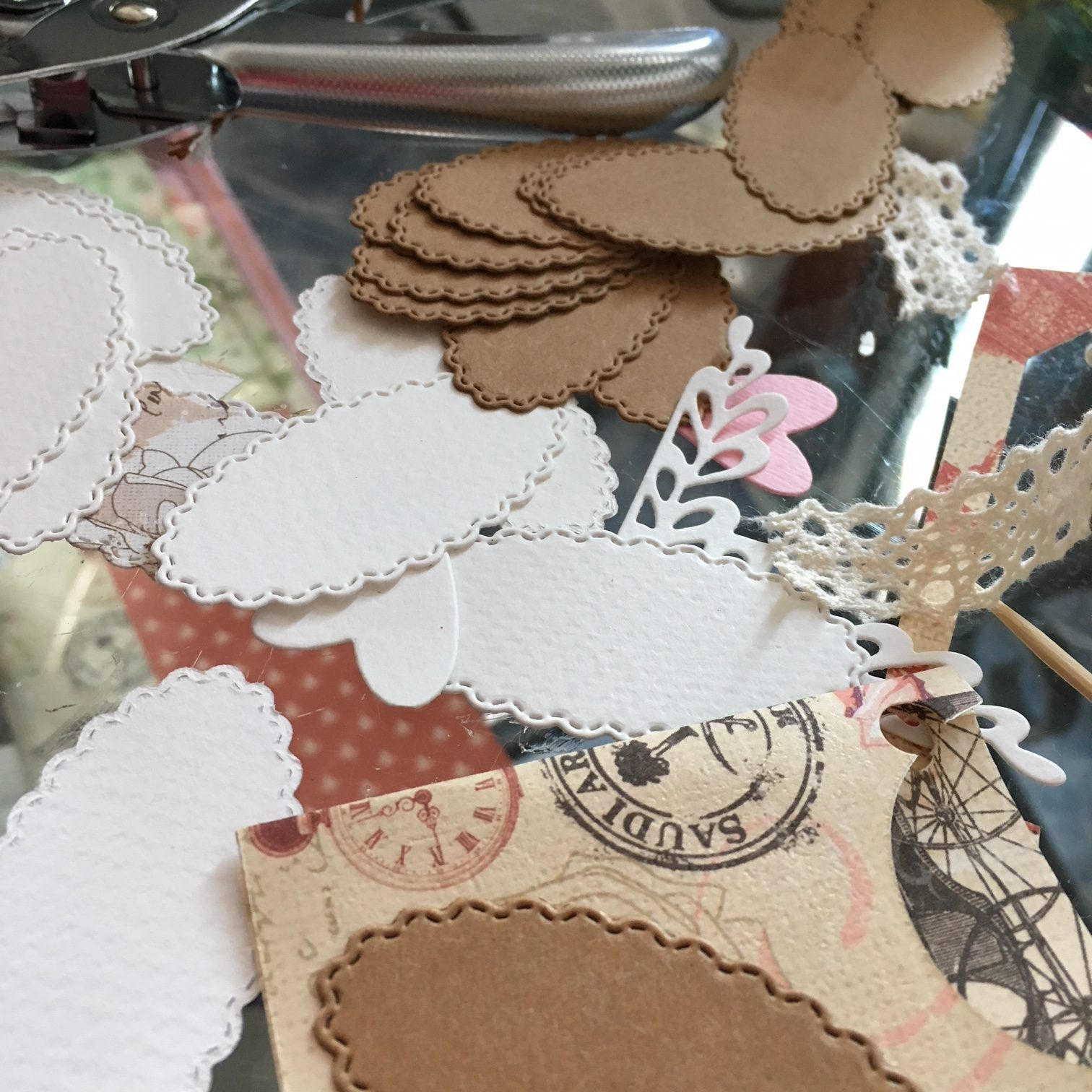 craft materials - cotton lace, paper tags and labels, punch tool, designers paper