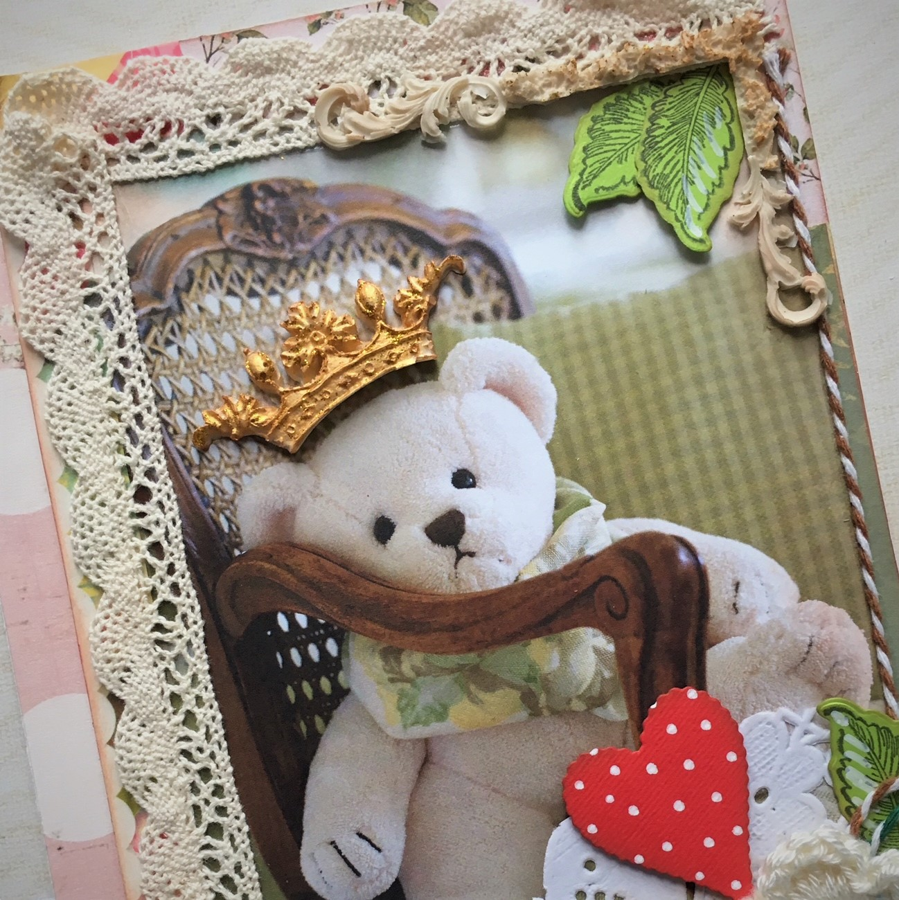 Teddy Bear scrapbook project - picture of a white teddy bear tow with resin crown, lace and red hearts with dots