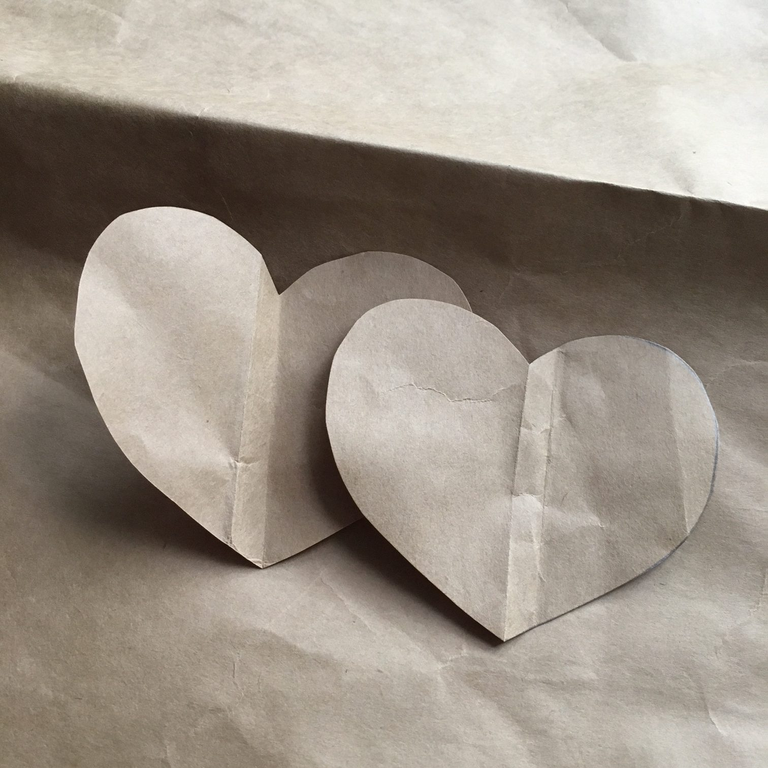 how to make brown bag paper hearts - first cut two heart shapes the same size