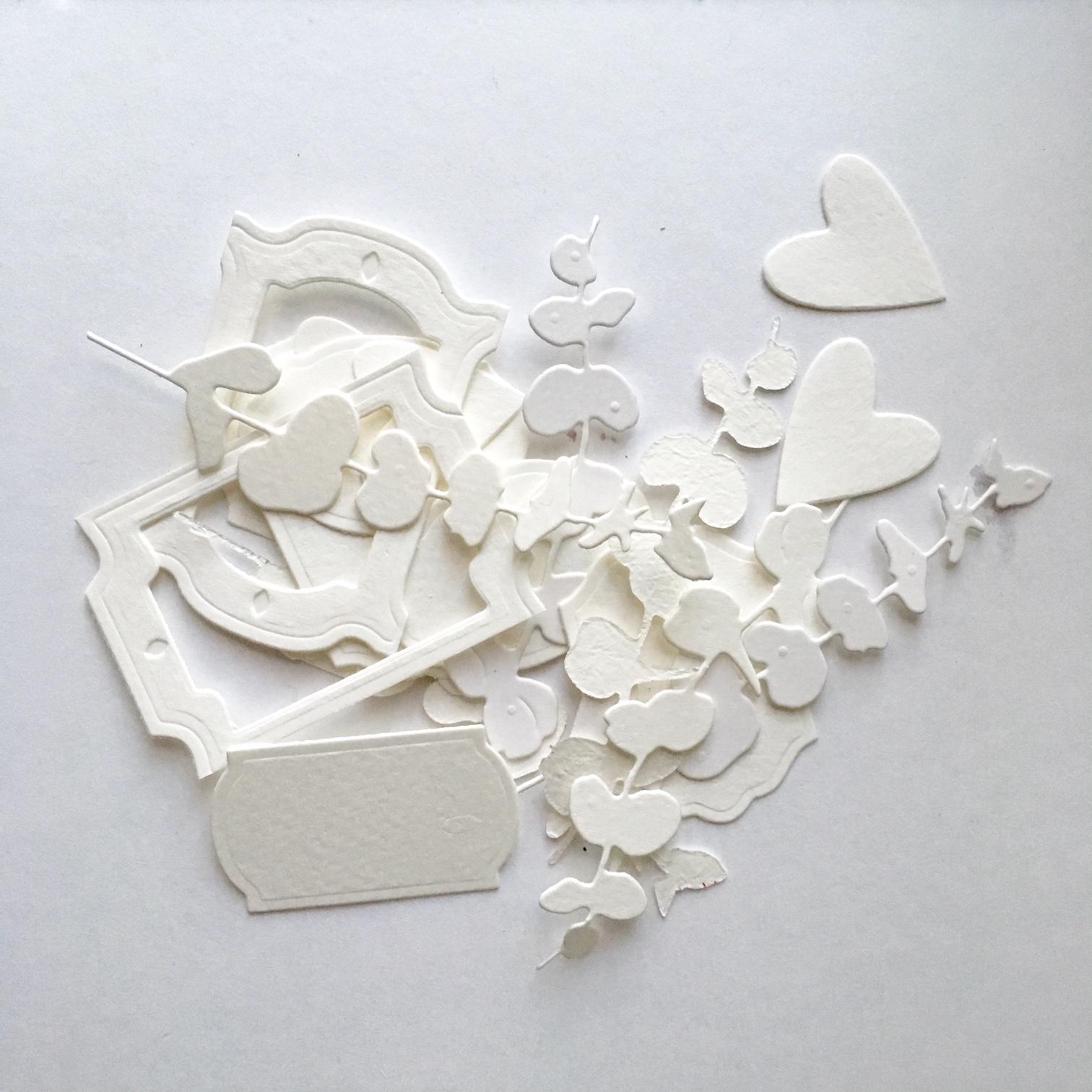 little paper elements cut using Sizzix Big shot machine