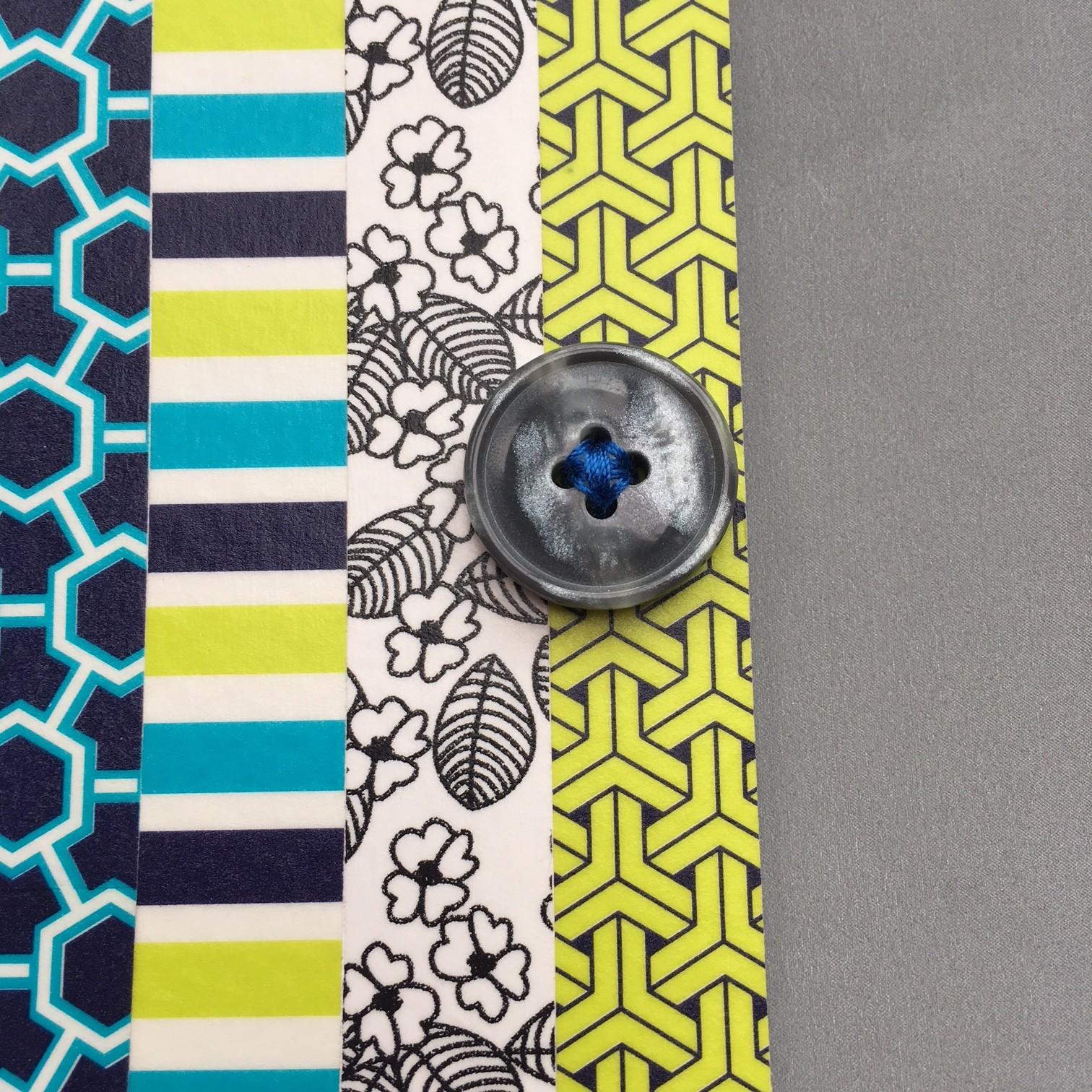 Using a bright colour thin cotton thread sew the button