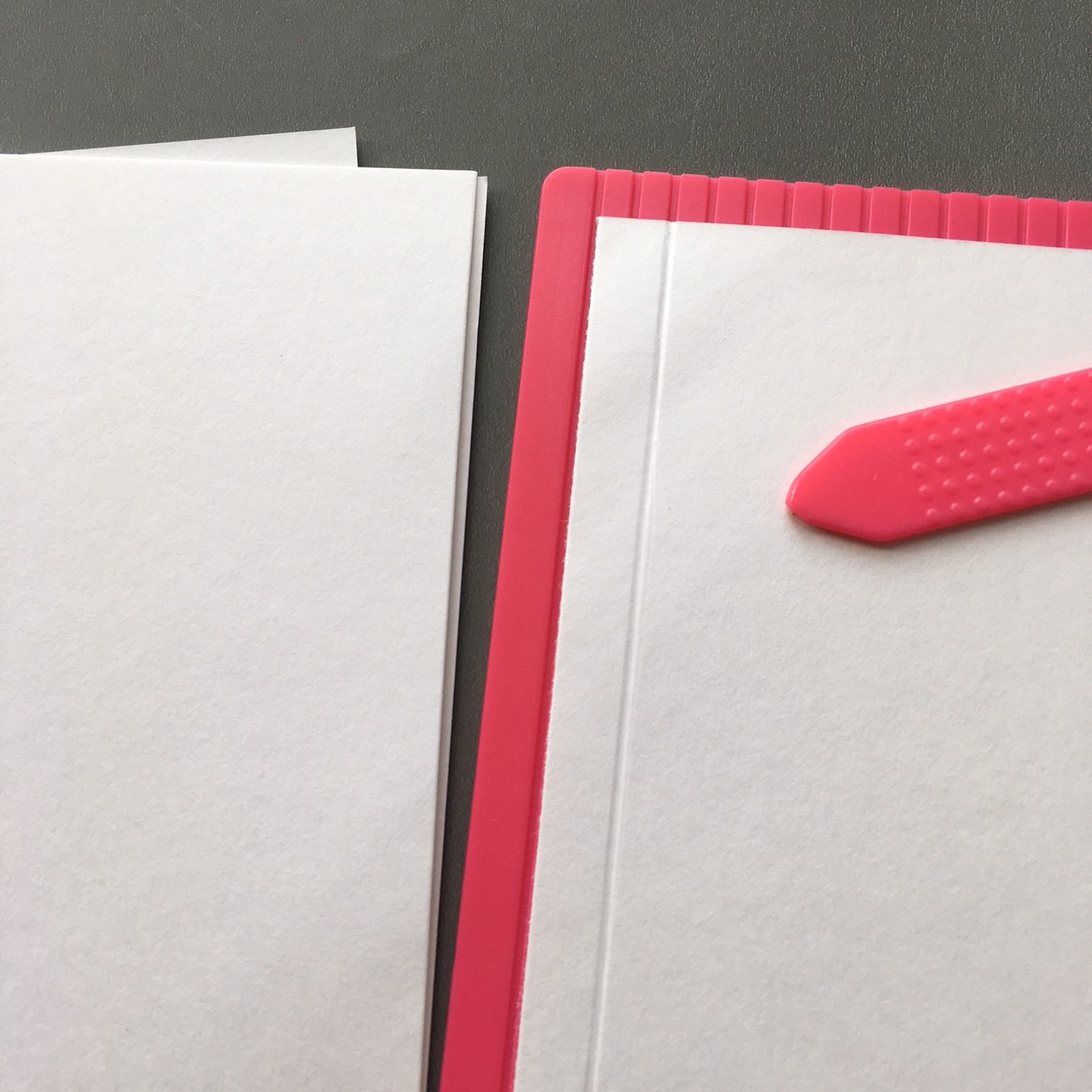Creasing 1-2 cm from the edge will help you fold the paper pieces