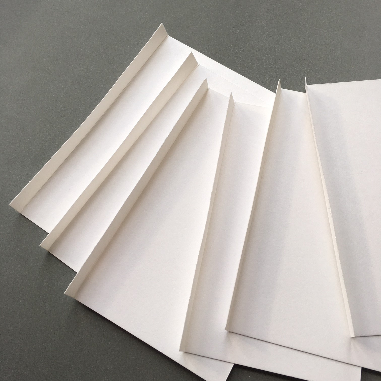Making the accordion-like notebook shape - creased and folded paper pieces