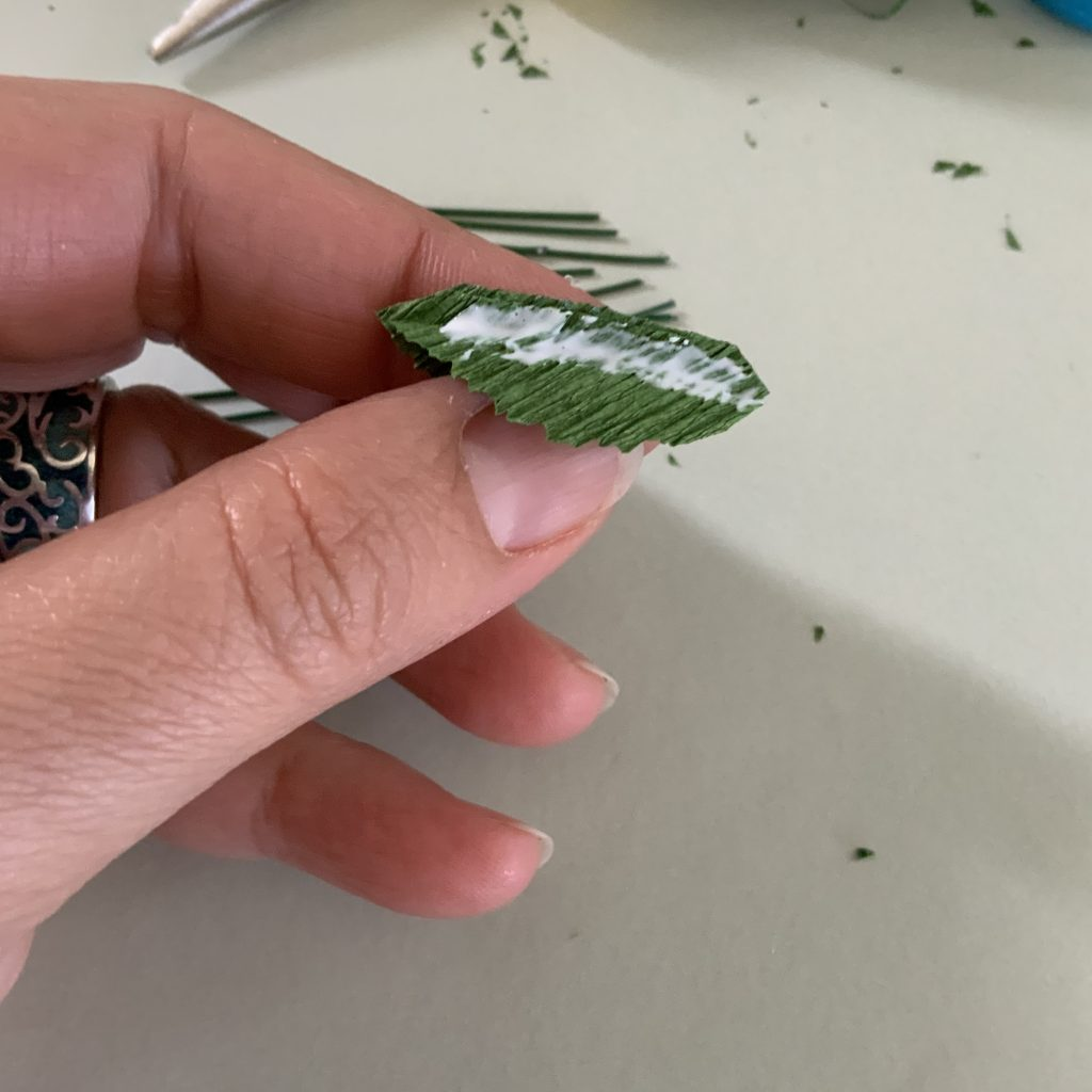 how to connect the wire to the crepe paper leaf