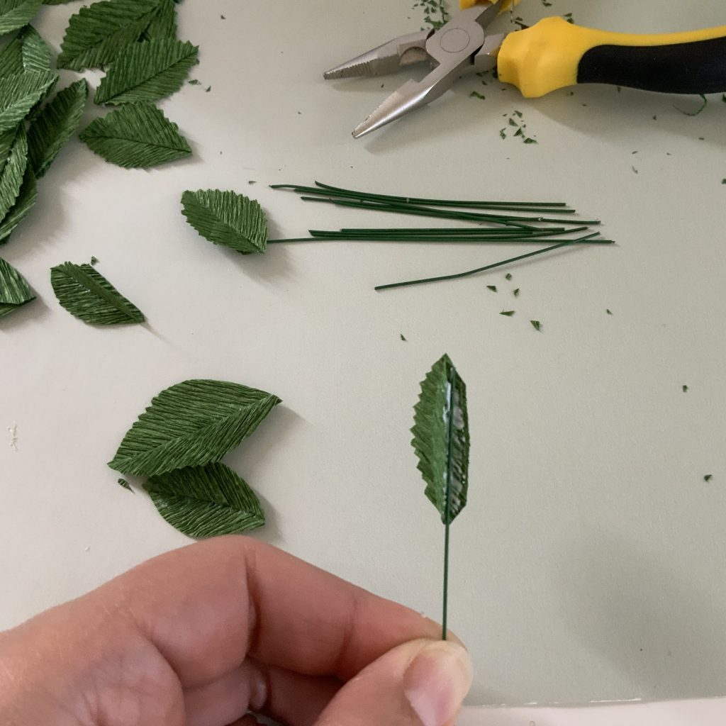 connecting the wire stem to the crepe paper leaf