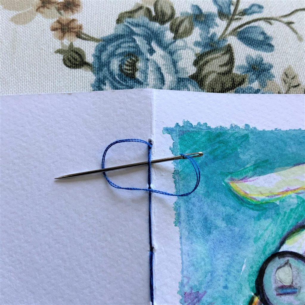 sew the pages of the boat observation tracker notebook together