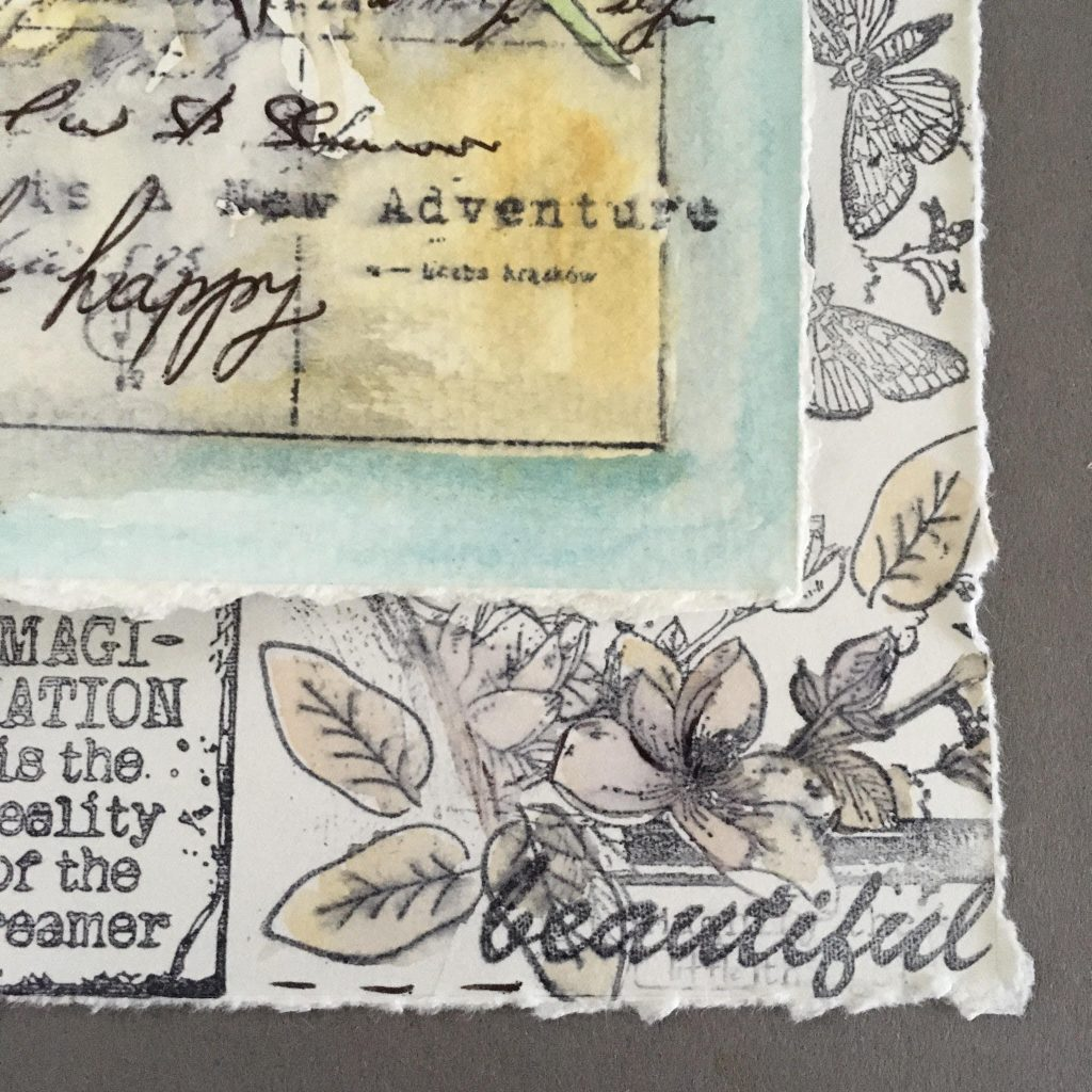 """gluing the flower watercolour stamped piece in the top of the """"frame"""""""