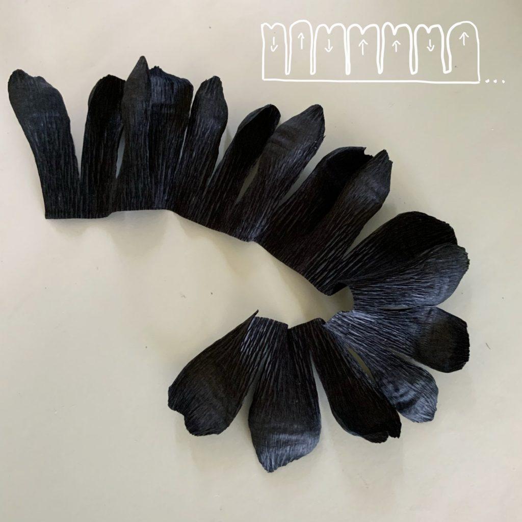 a garland of black peony petals
