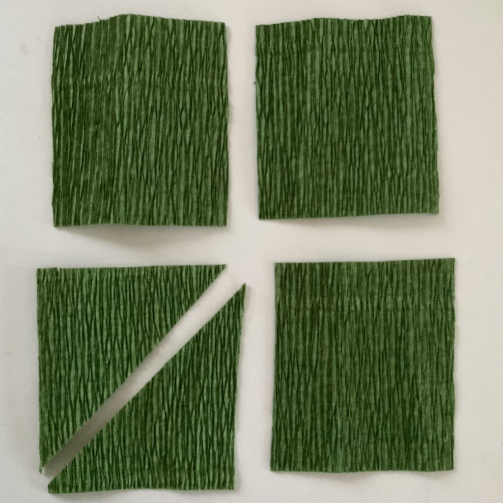 making the stem leaves, starting  with green paper rectangles