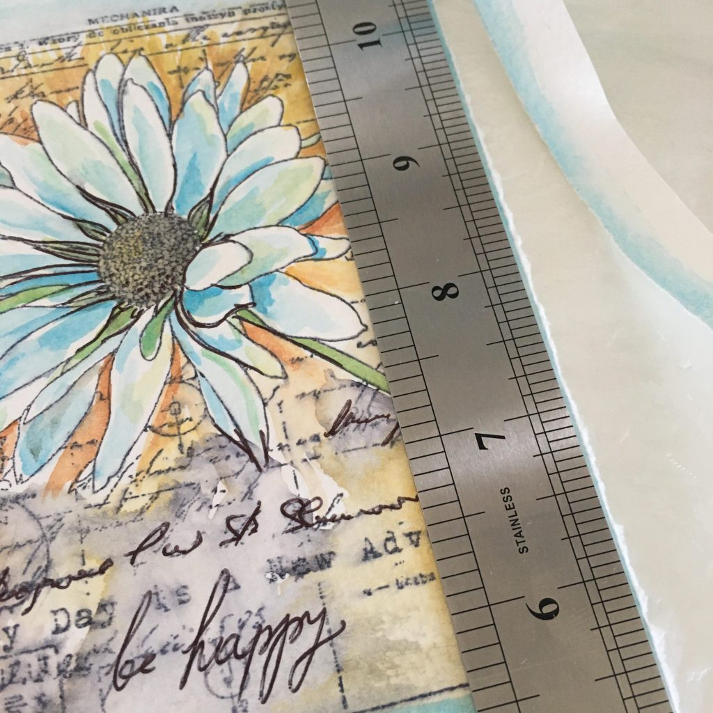 tearing the edges of the stamped paper to make it look a bit as a handmade paper