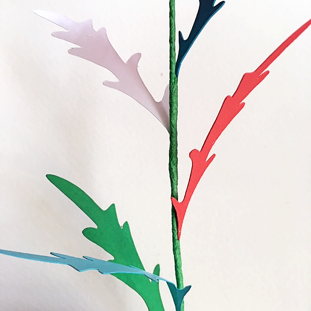 """add different colours leaves for more dense """"greenery"""". Here I added white, blue, red and green leaves"""