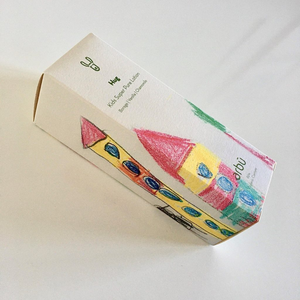 Hug - Kids Super Pure Lotion - white paper box with kid's drawing of houses and tree